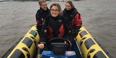 3 women on a powerboat